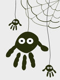 Spider with hand prints halloween background. Vector Stock Image