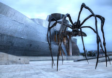 Spider Maman. Bilbao, Spain, July 2, 2014: spider titled Maman by Louise Bourgeois next to the Guggenheim museum Royalty Free Stock Photography