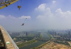 Spider-Man climbing the roof and jumped from the roof. Spiderman climb more than 280 meters of high-rise buildings, and jumped down from the top floor. Air Stock Photo