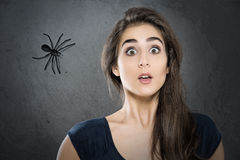Spider phobia. Young Woman with Spider phobia