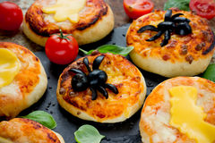 Spider pizza on Halloween, funny idea food recipe for kids Stock Image