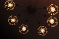 Spider type chandelier with hanging bulb lamps royalty free stock photos
