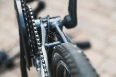 Spider web on bicycle gear. It has not been used for a long time. A dense web is located on the gear and chain transmission of a modern bicycle royalty free stock photography