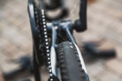 Spider web on bicycle gear. It has not been used for a long time. A dense web is located on the gear and chain transmission of a modern bicycle stock photo