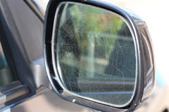 Spider web on car mirror Royalty Free Stock Photos