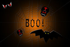 Spider web with spiders and a bat, with text boo in the center Stock Images