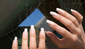 Spider woman -2. Fingers of a young girl spinning a network Royalty Free Stock Photography