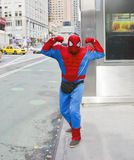 Spiderman in the City. A man dressed as Spiderman flexing Royalty Free Stock Photos
