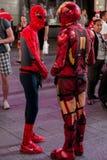 Spiderman and Ironman exchange money Stock Photos