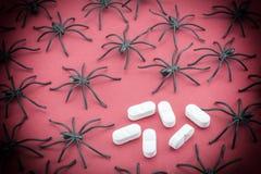Spiders around capsules, concept phobia Stock Images