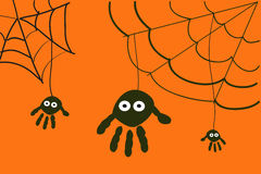 Spiders with hand prints halloween background Stock Photos