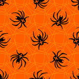 Spiders on Webs seamless pattern. On orange background Stock Images