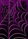 Spiderweb. Spooky spiderweb on a grunge background of violet and black - Great background image for Halloween Royalty Free Stock Photo