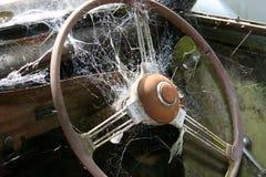 Spiderweb auf steeringwheel Lizenzfreie Stockfotos