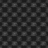 Spiderweb pattern on black fabric. Royalty Free Stock Photos