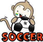 Spiel des Affejungen froh mit einem Ball Stockfoto