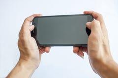 Spiel Gamer auf Smartphone Stockfotos