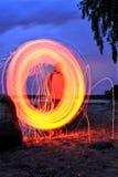 Spiel mit Feuer Stockbild