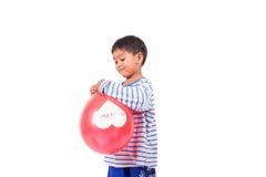 Spielballon des kleinen Jungen Stockfotografie