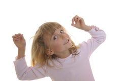 Spiele des kleinen Mädchens mit seinem Haar Stockbild