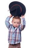 Spiele des recht kleinen Jungen mit Cowboyhut Stockbild