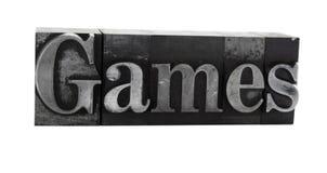 ?Spiele? im alten Metalltypen stockbild