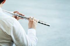 Spielen der Flöte Stockbilder