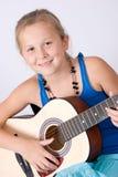 Spielen der Gitarre Lizenzfreies Stockfoto