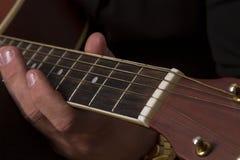 Spielen der Gitarren-Hand Stockfoto