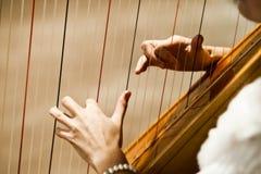 Spielen der Harfe Stockbild