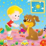 Spielen des Jungen und des Hundes Lizenzfreies Stockfoto