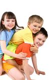 Spielen mit drei glückliches Kindern Lizenzfreie Stockbilder