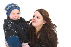 Spielen mit Mamma im Schnee Lizenzfreie Stockbilder