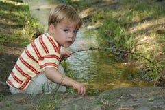 Spielen mit Wasser Stockbilder
