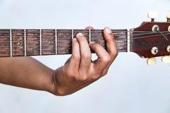 Spielen Sie die Version 16 der Gitarre eigenhändig Stockfoto