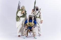 Spielen Sie realistischen silk weißen Miniaturhintergrund der Mannsoldat-Action-Figur Stockbilder