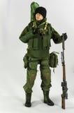 Spielen Sie realistischen silk weißen Miniaturhintergrund der Mannsoldat-Action-Figur Stockfotografie