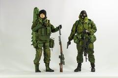 Spielen Sie realistischen silk weißen Miniaturhintergrund der Mannsoldat-Action-Figur Lizenzfreies Stockbild