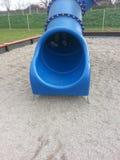 Spielen am Spielplatz Stockbilder