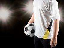 Spieler, der Ball hält Stockfotografie