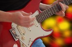 Spieler der elektrischen Gitarre Stockbild