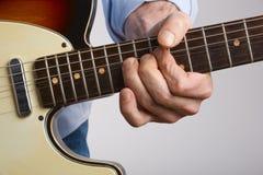 Spieler der elektrischen Gitarre Stockfotografie