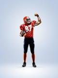 Spieler des amerikanischen Fußballs im Aktionsweiß lokalisiert stockbild