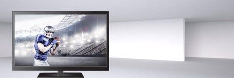 Spieler des amerikanischen Fußballs im Fernsehen Lizenzfreie Stockfotos