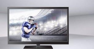 Spieler des amerikanischen Fußballs im Fernsehen Stockfotos