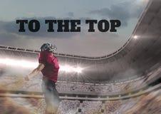 Spieler des amerikanischen Fußballs im Stadion mit Motivtext Stockbild
