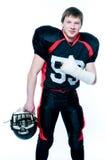 Spieler des amerikanischen Fußballs mit der gebrochenen Hand Lizenzfreie Stockfotografie