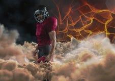 Spieler des amerikanischen Fußballs mit Feuerhintergrund Stockfotos