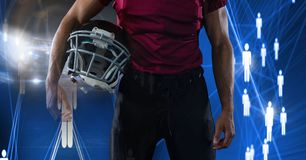 Spieler des amerikanischen Fußballs mit Leuteikonenübergang Stockfotos