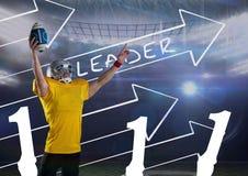 Spieler des amerikanischen Fußballs mit Pfeilen im Hintergrund Stockfotos